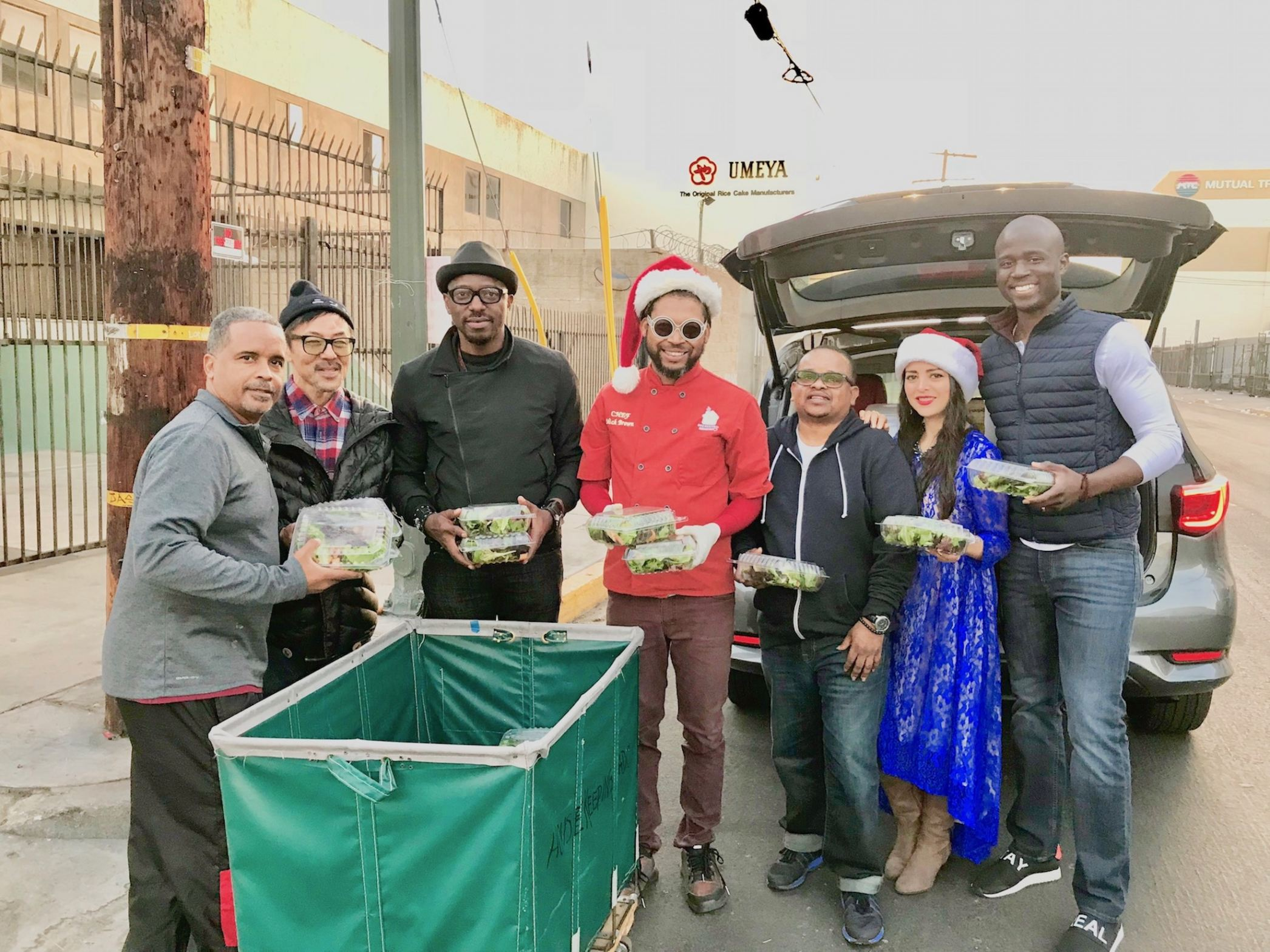 Chef Mick Brown as Santa on Christmas Eve distributing salads on LA Skid Row